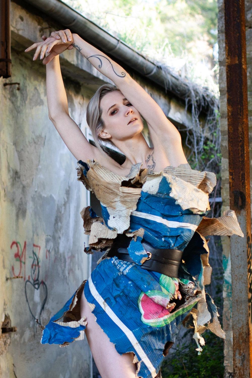 Roxanna Walitzki, shot by Redd Walitzki, at Pula's abandoned naval base, wearing discarded paper.