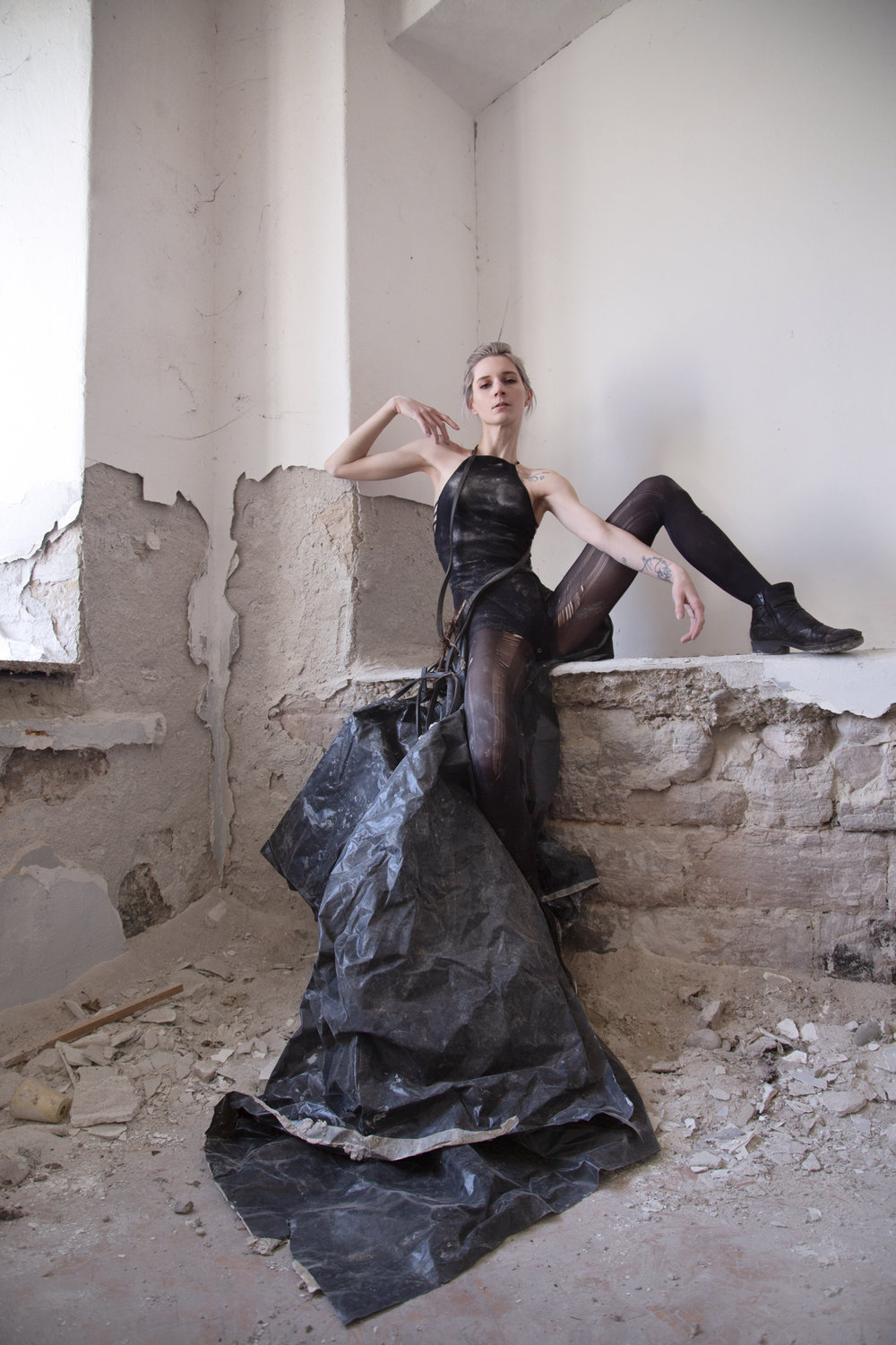 Roxanna Walitzki, shot by Redd Walitzki, in an abandoned building, wearing a dress constructed from plastic tarp and rope sourced on site. Pula, Croatia