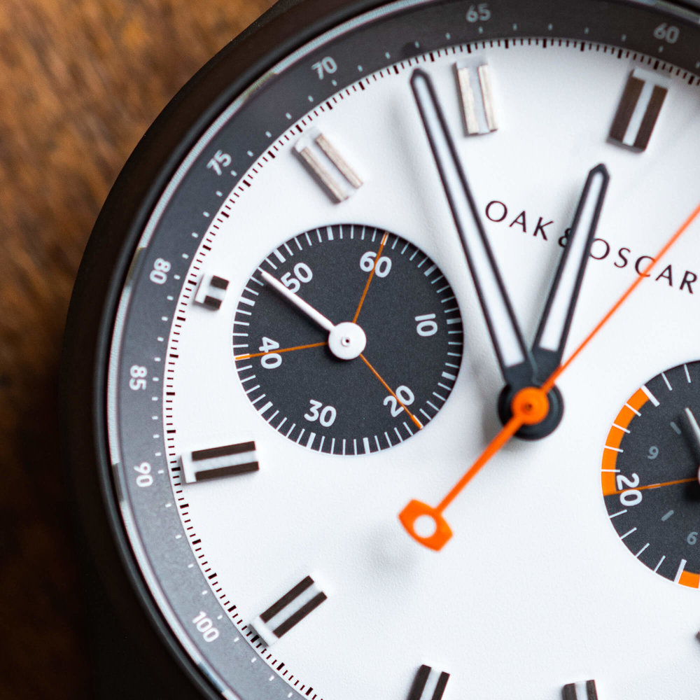running seconds - The running seconds at 9 o'clock is one of our favorite details of Batch Nº1. The contrast between the numerals, the white tick marks and the charcoal subdial is visually striking. Add in the orange cross hair and the subdial really sings.
