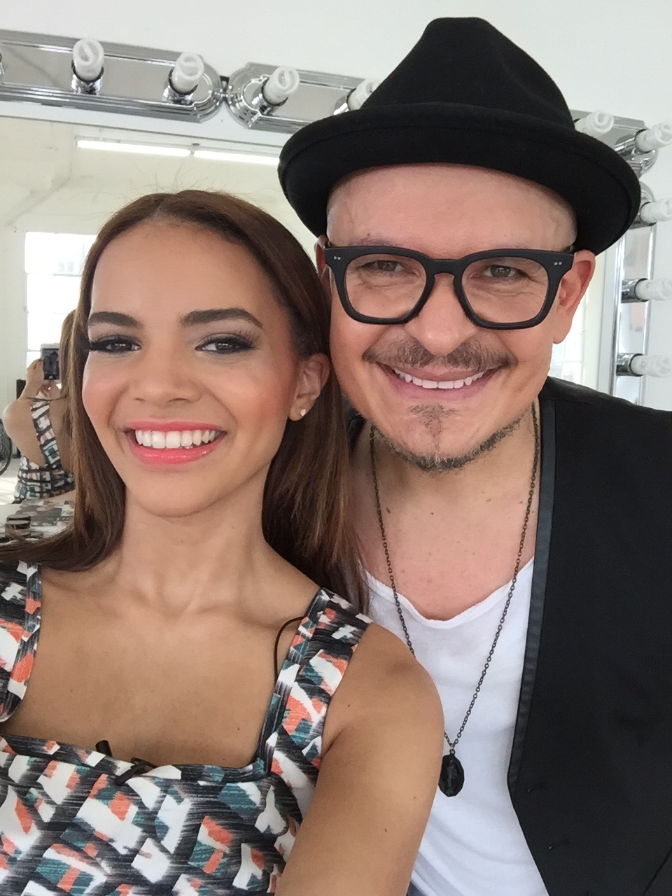 Luis Casco on set with Leslie Grace