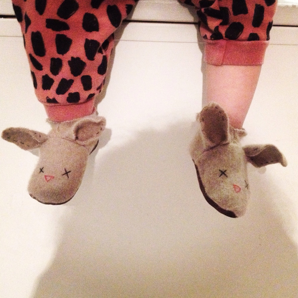 Viv modeling the 12-18 month bunny slippers