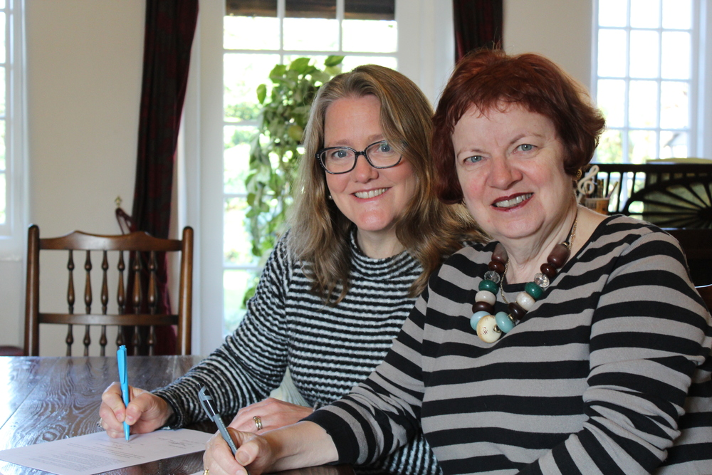 Mary Hoffman and Sarah Towle ink deal for IN THE FOOTSTEPS OF GIANTS, subject of our coming Kickstarter Campaign.