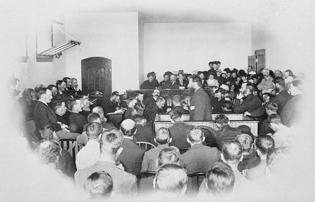 Riel standing at his trial, 1885