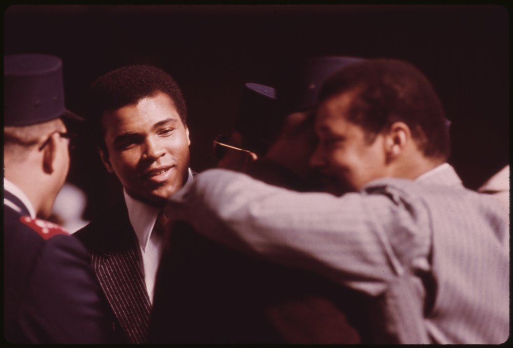 WORLD_HEAVYWEIGHT_BOXING_CHAMPION_MUHAMMAD_ALI,_A_BLACK_MUSLIM,_ATTENDS_THE_SECT'S_SERVICE_TO_HEAR_ELIJAH_MUHAMMAD..._-_NARA_-_556247.jpg