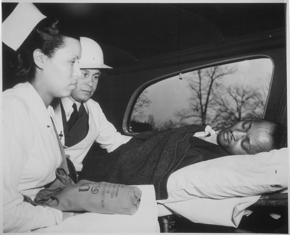 Charles Drew (back) as the physician for an air-raid victim,  ca. 1941 - ca. 1945 Source: U.S. National Archives and Records Administration
