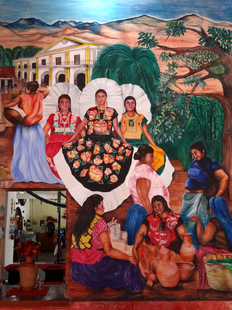 A mural featuring women in traditional Zapotec dress.