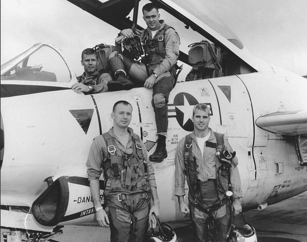 Lieutenant McCain (front right) with his squadron and T-2 Buckeye trainer, 1965