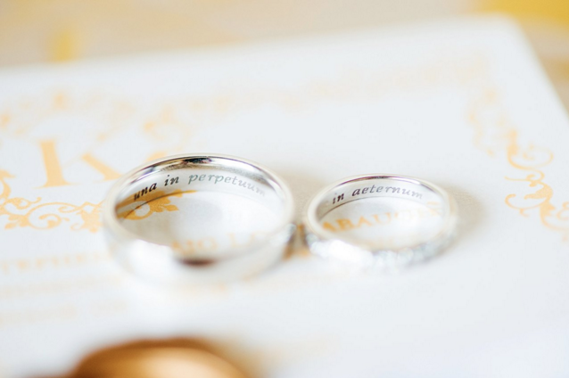 "The inside of their wedding bands are engraved with ""una in perpetuum"" meaning ""together forever"" and ""in aeternum"" meaning ""eternally."""