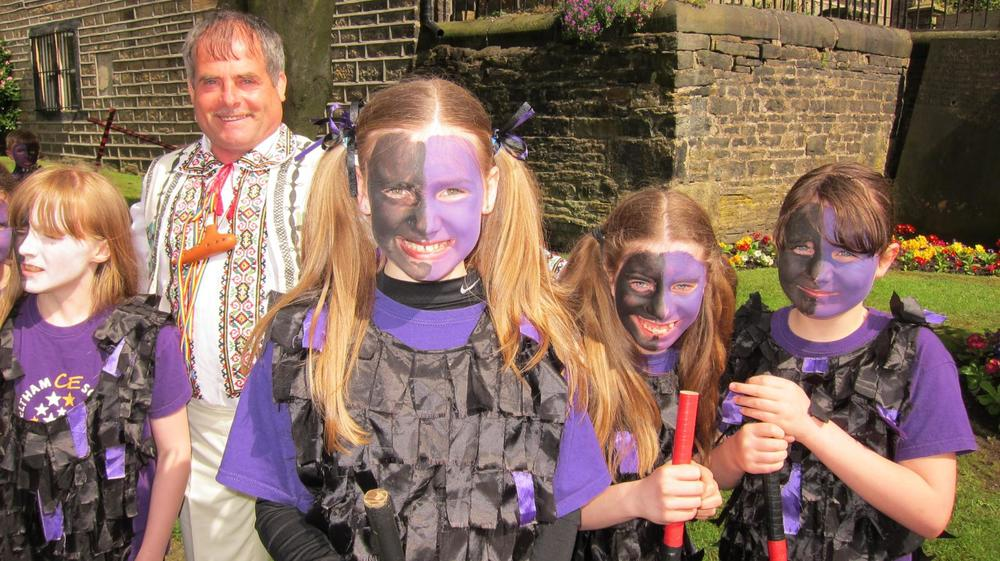 Trio participant with local children taking part in a music festival in Yorkshire.