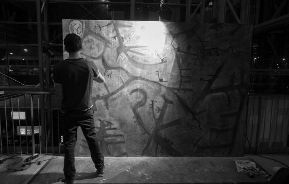 Drawing Urbo Kune at Muziekgebouw aan 't IJ. Photo by Canan Marasligil