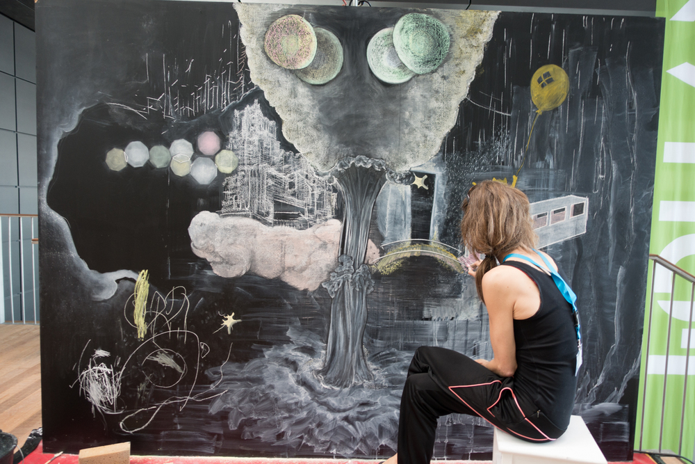 Artist Judith Wittemanworking on her utopic city during Urbo Kune atthe Muziekgebouw aan 't IJ.Photo by Canan Marasligil