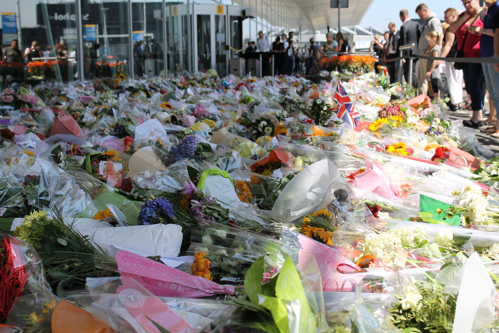 Flowers at Schiphol airport in memory of the victims. Photo by  Javier Santos .