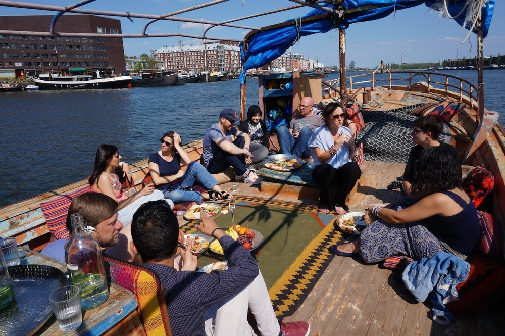The Living Room took place on a boat in Amsterdam in April and May 2016. Photo via  Migrationlab.org .