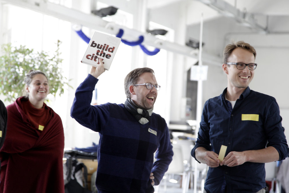 Our colleague Philipp Dietachmair holding our Build the City Book and our partner Jotham Sietsma (MitOst) at a Tandem Europe meeting (photo by Constanze Flamme)