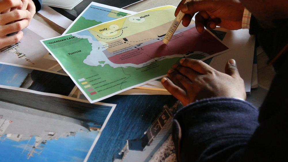 Project  The Left-to-Die Boat:  Still from the video interview with survivor Dan Haile Gebre, conducted by Lorenzo Pezzani and Charles Heller, Milan, 21 December 2011. In this still, we see an early sketch of the chain of events map being used to help Gebre recall the events. Image: Forensic Oceanography, 2011
