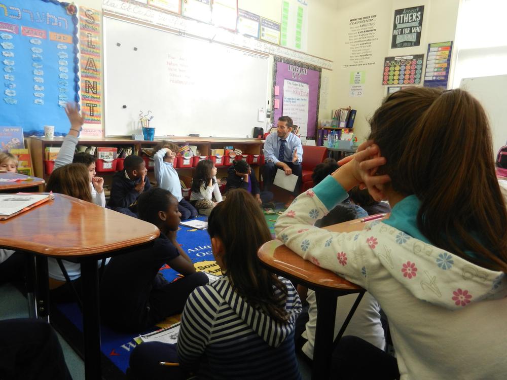 Teachers in APOQ workshop doing a lesson-plan. 2016.