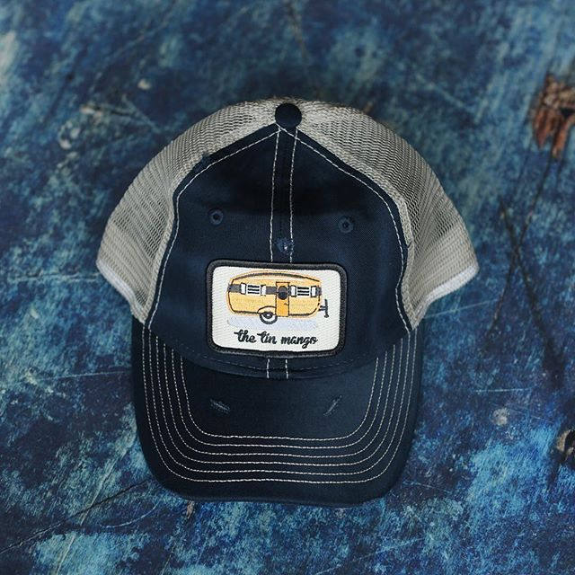 "You can get your very own ""The Tin Mango"" hat online. Link in bio. $5 from each sale goes to the @aashafund #vintagecamper #truckercap #happycamper #aashafund"