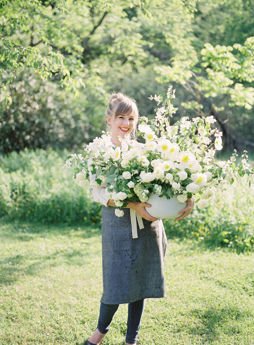 "ABOUT KELLY PERRY - Before you could find her empowering professionals in the floral industry full-time, Kelly started a tiny weekly flower subscription that she grew into her own successful boutique floral design business, Philosophy Flowers.Kelly Perry's life with flowers—and her joy of teaching other professionals—naturally stems from her time working as a corporate event planner after she graduated from college, studying fashion, interior design, event planning, entrepreneurship, and education. Of her educational background, Kelly reminisces, ""The first lesson I taught in my education class was called 'The Elements and Principles of Design.' I practically floated out of that class, and I remember thinking, 'If I could find a way to just teach that lesson for the rest of my life, I would be so happy.' It combined everything I loved: fashion, interior design, business, event design, art, and education."