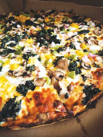 Signature GF Spinach Pizza at Stadium Market  (photo by Brandi Lyons)