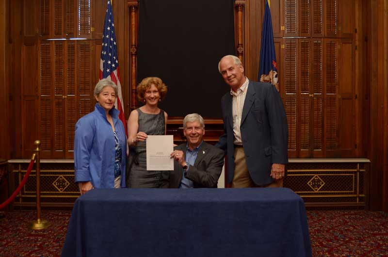 Signing of the bill with Gov. Snyder, Roger Newton,  Coco Newton, and Judy Stone