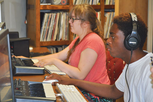 Students at Neutral Zone's music video camp 2017 composing at beat making stations