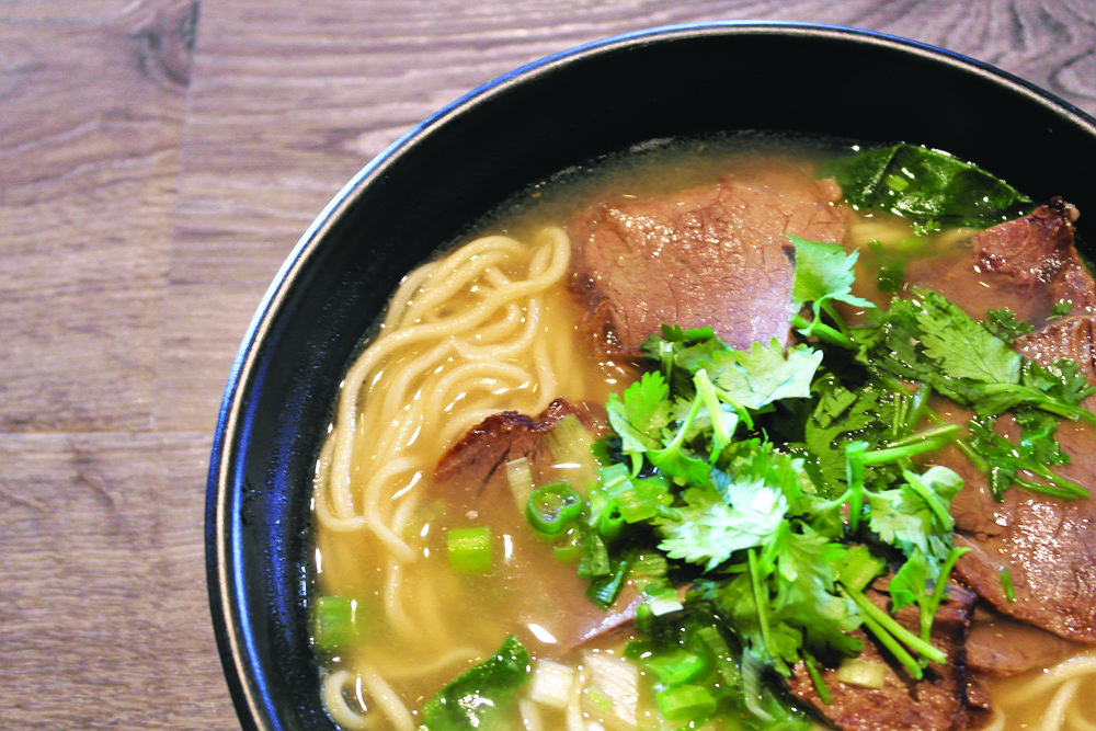 My beef noodle bowl had a rich broth, juicy slices of beef, scallions, and mild yet flavorful noodles.