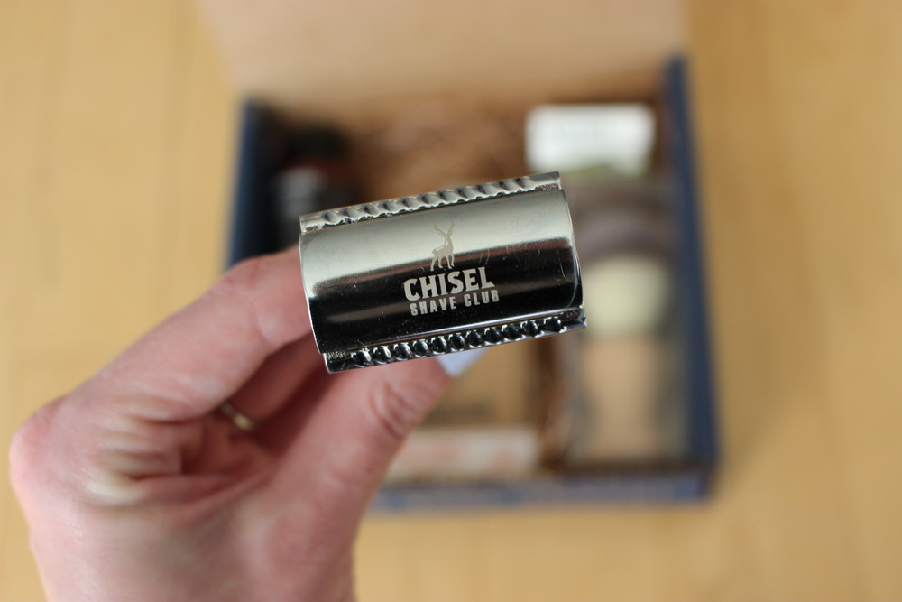 The safety razor with the Chisel logo.