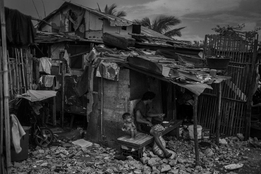 Fabon family outside their house in Baseco, Manila.