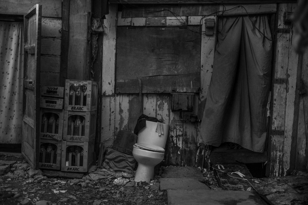 A toilet that is not used because there's no sewage is seen outside a house in Baseco.
