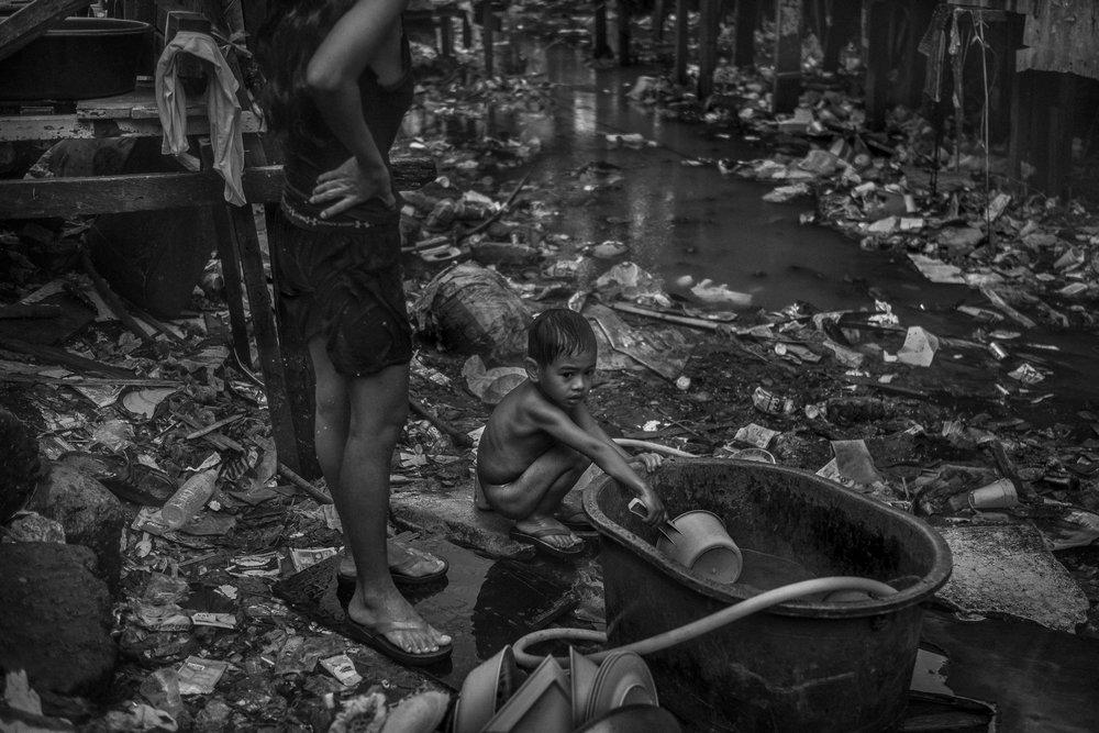 A young boy takes a bath in Estero de Magdalena.