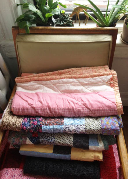 The only thing better than a pile of quilts is being snuggled up underneath them!