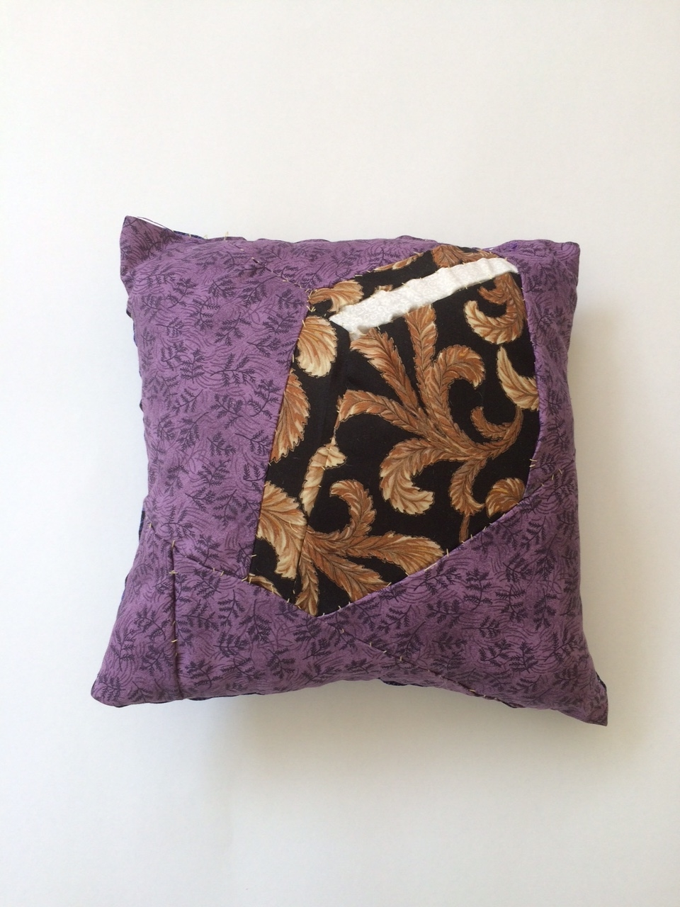 This pillow depicts a closed book seen on an angle.
