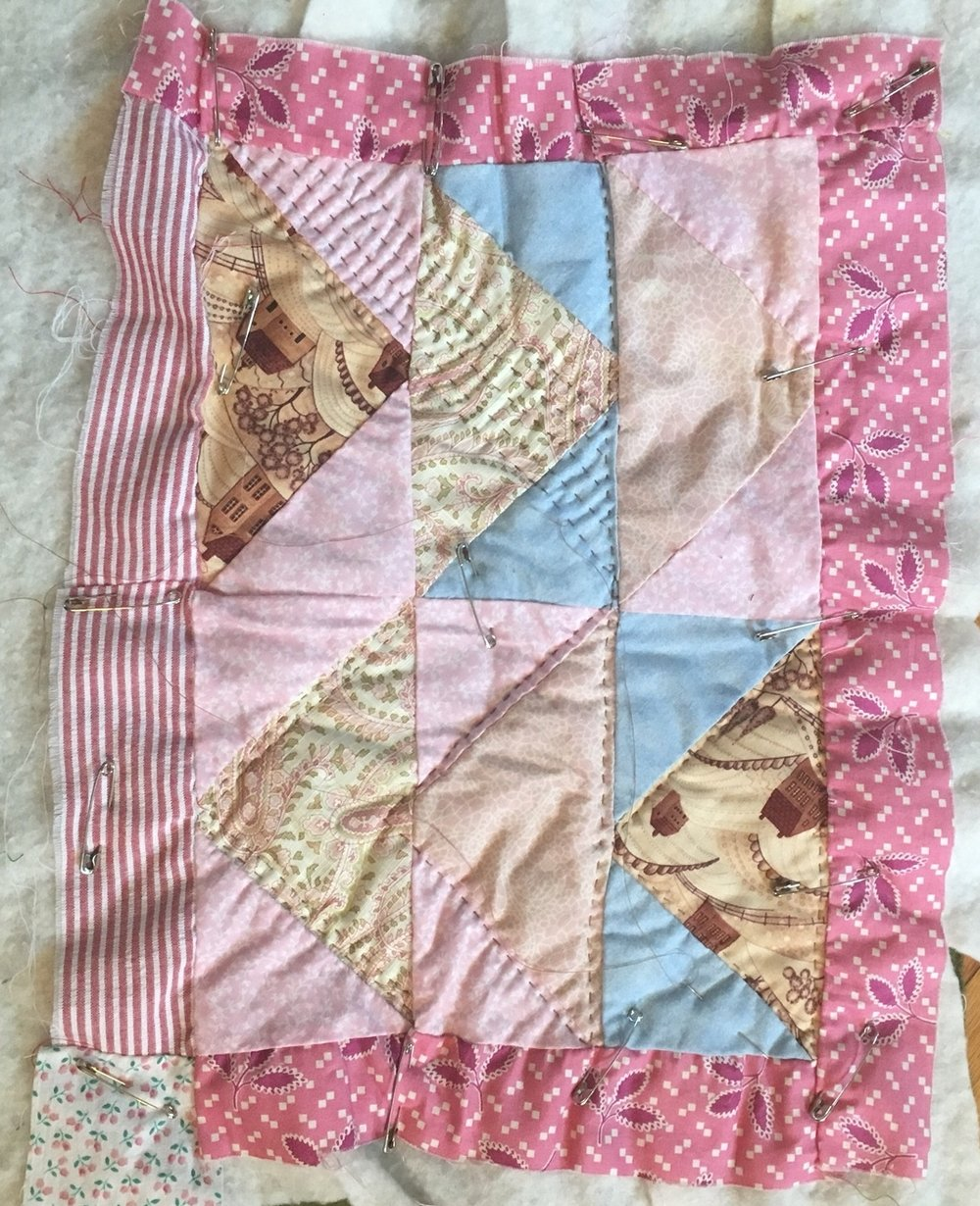 I loved this out of character pink leaf fabric and I think these are the last scraps I had. I made this mini to try flying geese, and i've never attempted them again! The red seersucker and pink floral square are vintage scraps.