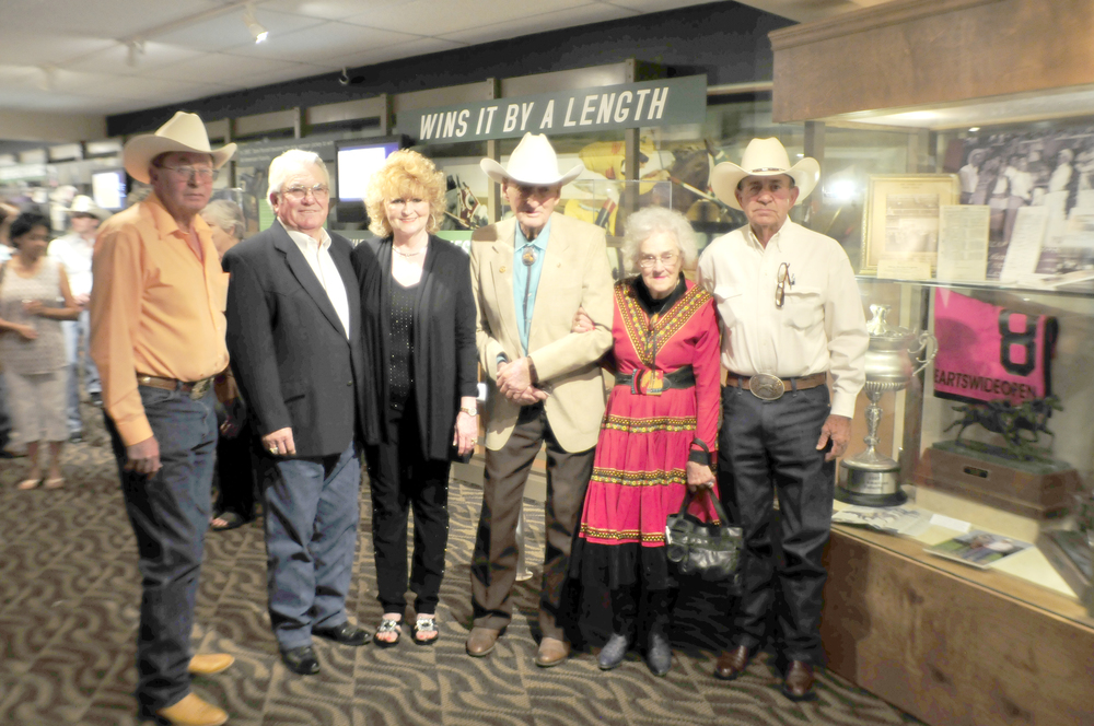 Photo: From left to right, Carl Draper, Larry and Teresa Teague, Punch and Suzanne Jones, and Cliff Lambert standing by the case honoring their lifelong accomplishments. Photo courtesy Ruidoso Downs Racehorse Hall of Fame by Ty Wyant.