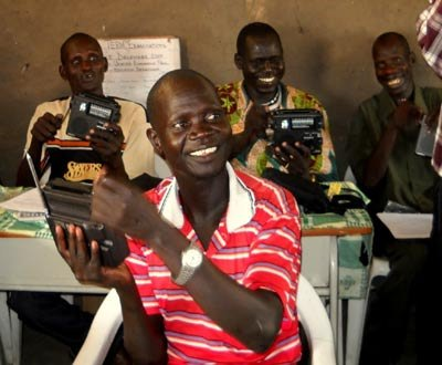 Teachers in South Sudan learning how to use ETOW's self-powered hand-crank shortwave radios.