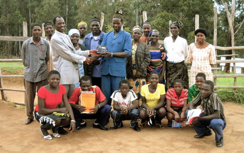 Mr. Ndomi Patrick Ndi and his students from G.S.S. Mbu-Warr receiving their first ETOW self-powered, world-band radio.