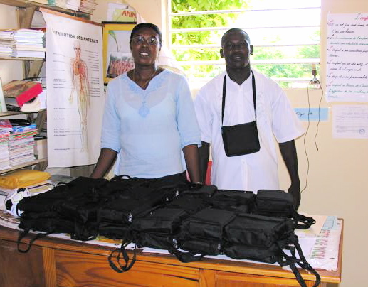 Teachers at the Petite-Rivière school prepare to distrubute ETOW radios to all of their teachers. Radios shown in their protective carry cases.