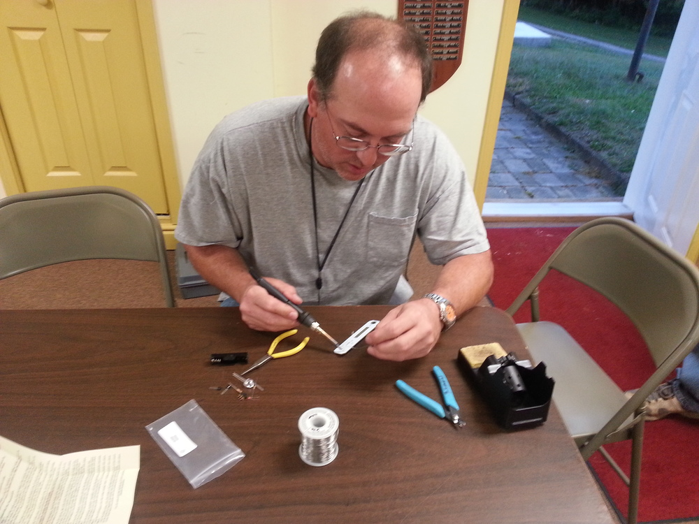 Dewey, W3VYK, having fun and soldering his Humana Light. (Photo Credit: John Hoffman K3STL)