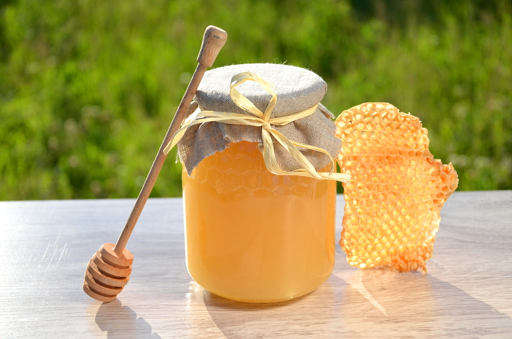 bigstock-piece-of-honeycomb-honey-dipp-46687921.jpg