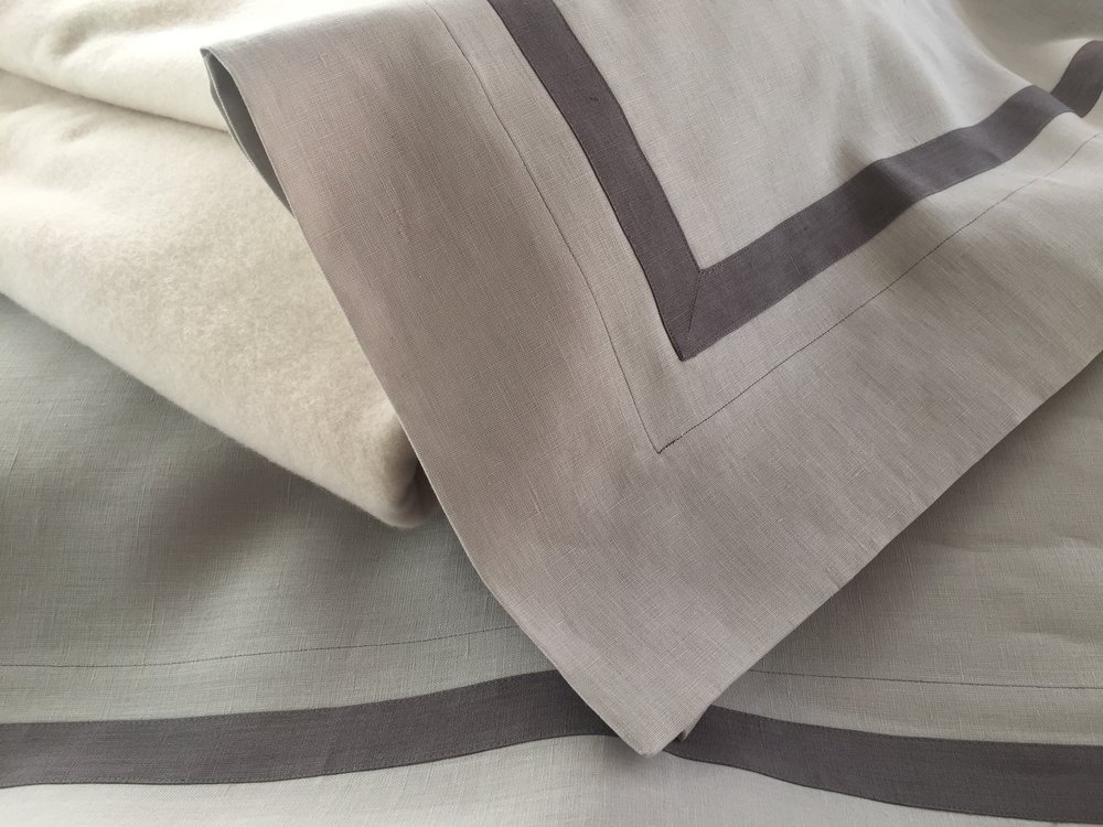 Kearsley Jennifer Linen Sheets in Pale Grey with Stone 1 inch contrasting band and stitch and Vanilla St Anton Cashmere blanket.jpg