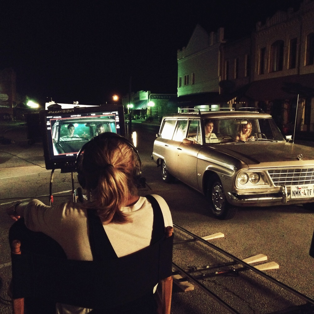 Anna behind the directors monitor during a scene with Imogen Poots & Mackenzie Davis