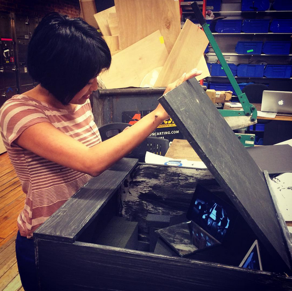 Jenn de la Vega checking out the inside of our box.