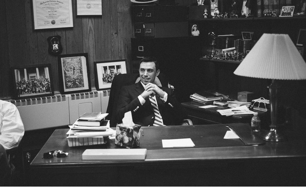 Groomsman at Desk