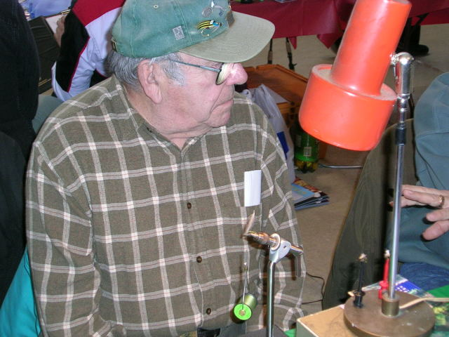The king of fly tying, and painter's muse, Dick Hepper, showing off his vice prowess.  The guy has mad skill.