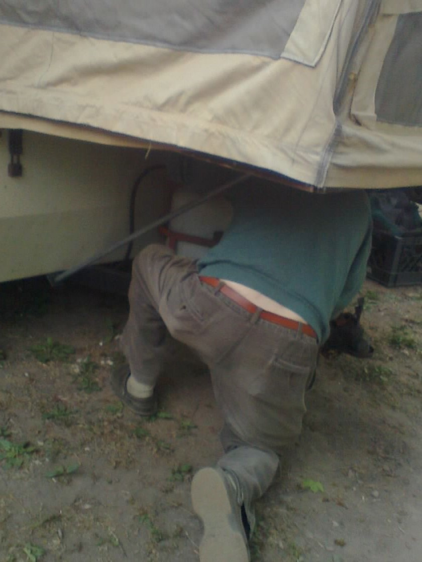 Dick's not afraid of getting dirty when there's work to be done.  Here he is hooking up his propane tank.
