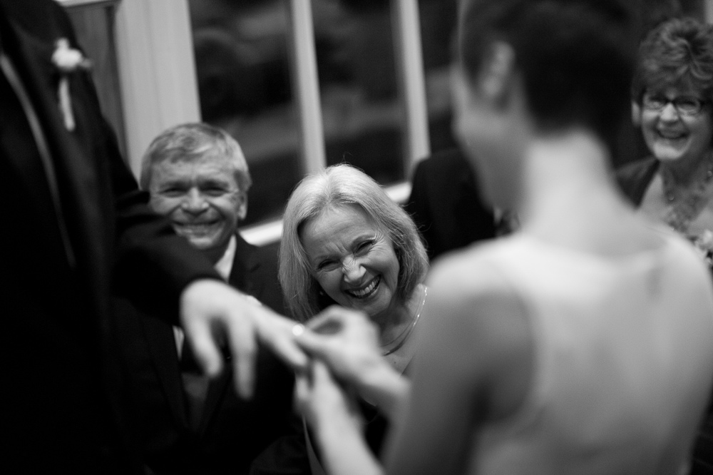 Olga + Jeff's parents react with smiles and laughter as they exchange rings during their intimate winter wedding at Langdon Hall in Cambridge, Ontario.