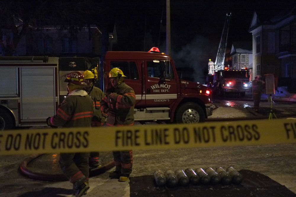 Wilmot Township firefighters battle a blaze on Peel St. in New Hamburg on the evening of January 29, 2014.