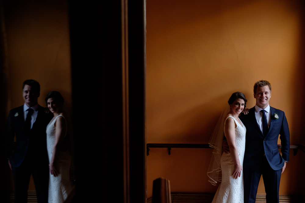 Emilie and John pose for a wedding portrait at the Gladstone Hotel.