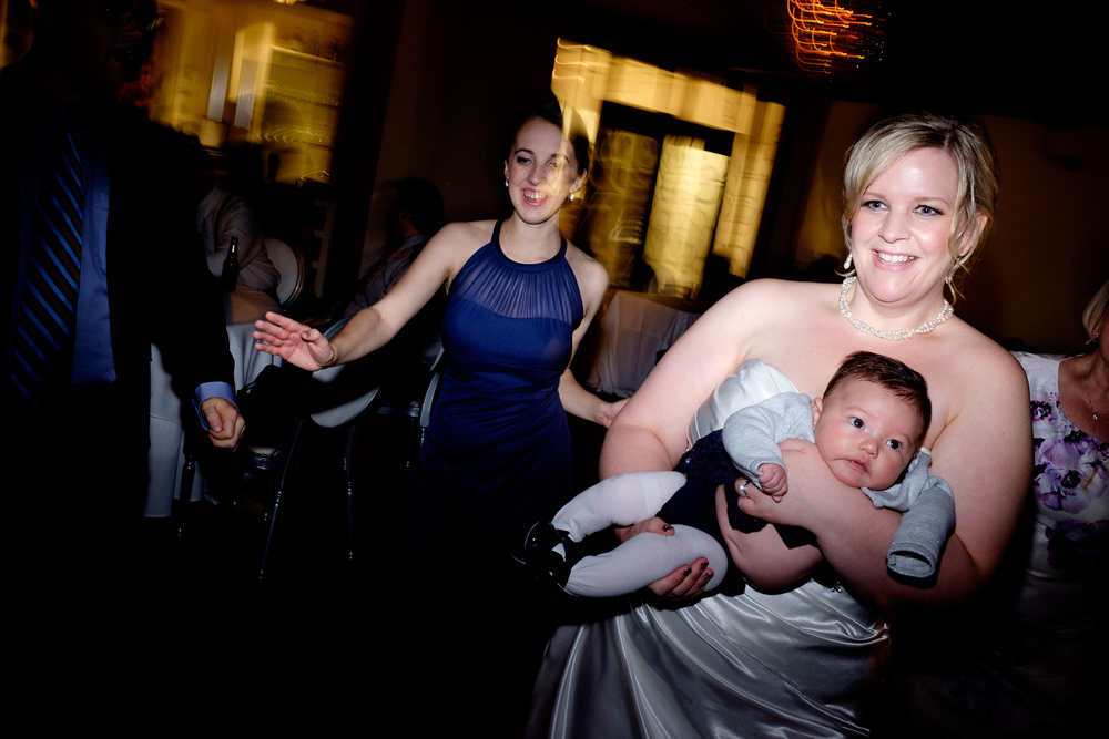The bride dances with her daughter during their wedding reception at Whistle Bear in Cambridge.