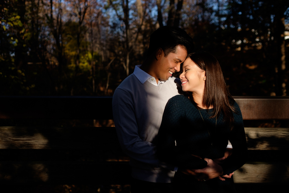 Haidie and Martin pose for some sunset portraits during their engagement session at Toronto's Edwards Gardens.